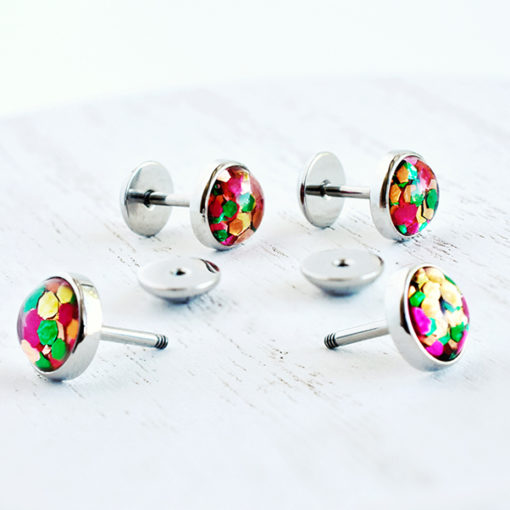 Funfetti ComfyEarrings on white wood surface.