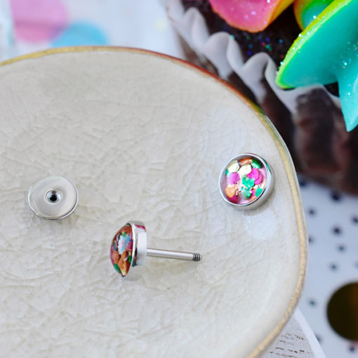 Funfetti ComfyEarrings on small crackled ceramic dish.