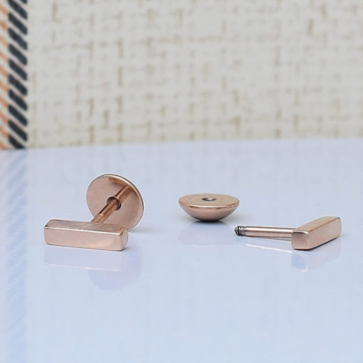 Rose Gold Bar ComfyEarrings on white dish.
