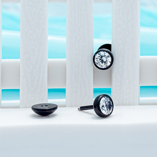 modern ComfyEarrings on mini white picket fence.