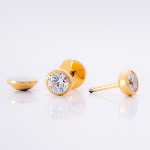 Crystal Clear Gold ComfyEarrings on shiny white background.