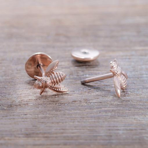 Rose Gold Bee ComfyEarrings on wood.